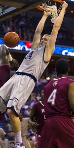 Georgetown Hoyas' Nate Lubick hangs on rim after a slam dunk. Lubick set a career high with 14 rebounds. The Georgetown Hoyas Men's Basketball team improved their record to 5 wins against only one loss with a victory over Indiana University-Purdue University Indianapolis Jaguars (IUPUI) at the Verizon Center on Monday, November 28, 2011.