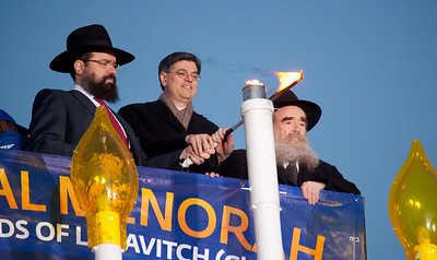 Rabbi Levi Shemtov, Office of Management and Budget Director Jacob J. Lew and Shemtov's father, Rabbi Abraham Shemtov, light the National Menorah. A special lighting ceremony took place for the National Hanukkah Menorah, the world's largest, on the Ellipse, just across from the White House on the first night of the eight-day Jewish holiday. The first candle was lit on Tuesday, December 20, 2011.