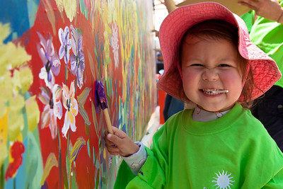 Children like Victoria Smith (3 yrs) show off their artistic talents by adding to a garden mural during Garden Fest - an annual all day family-friendly event presented by the Smithsonian Gardens at the Smithsonian Institution. The purpose of Garden Fest is to highlight each of the Smithsonian gardens and connect people to plants through educational demonstrations and engaging hands-on activities. At the Enid A. Haupt Garden on May 7, 2011.