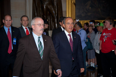 Mexican President Felipe Calderon (center right) strolls past tourists in the central rotunda of the United States Capitol in Washington, D.C. on May 11, 2011. He is accompanied by Senate Sergeant-at-Arms Terrance Gainer (left).