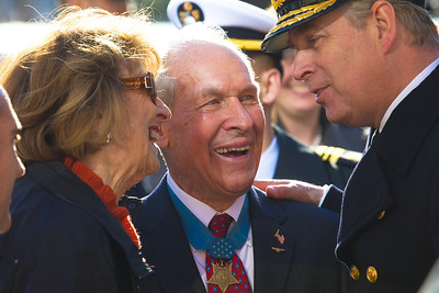 Britain's Prince Andrew, Duke of York (right), chats with American Medal of Honor recipient Tom Hudner and his wife Georgea, during a public wreath laying ceremony honoring the 100th anniversary of Naval Aviation on Thursday, December 1, 2011 on the Navy Memorial Plaza in Washington DC. Prince Andrew holds the actual rank of Commander and the honorary rank of Rear Admiral in the Royal Navy, in which he served as an active duty helicopter pilot and later instructor in helicopter flight. Thomas Jerome Hudner, Jr. is a retired officer of the United States Navy and a former naval aviator. Hudner rose to the rank of Captain and received the Medal of Honor for actions during the Battle of Chosin Reservoir in the Korean War.