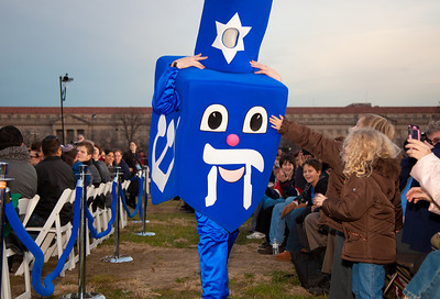 A special lighting ceremony took place for the National Hanukkah Menorah, the world's largest, on the Ellipse, just across from the White House on the first night of the eight-day Jewish holiday. In photo, Ephraim Kaufman, dressed as Dreidelman, entertains children. December 20, 2011.