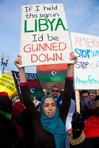 """If I held this sign in Libya, I'd be gunned down"". Hundreds of demonstrators gathered in front of the White House calling on the United States to do more to help liberate Arab nations. The protestors stood in solidarity with pro-democracy movements taking place in Libya, Yemen, Bahrain, Iraq, Iran and the Sudan. In Washington DC on Saturday, February 26, 2011."