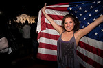 A jubilant Allyson Childress of Falls Church VA stands proudly behind the American Flag with the White House in the background. The announcement of the death of Osama Bin Laden sparked a spo ...