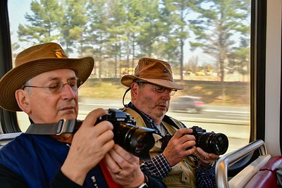 Brothers reviewing their photos