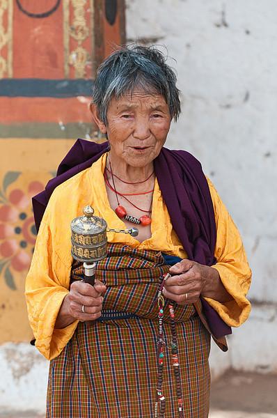 #Bhu 014 Woman with Prayer Wheel, Punakha Dzong, Bhutan