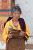 #Bhu 014 Woman with Prayer Wheel, Punakha Dzong, Bhutan