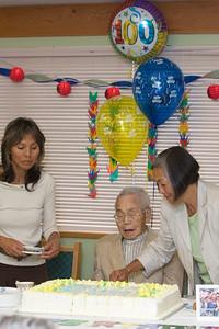 Lynne cuts the birthday cake