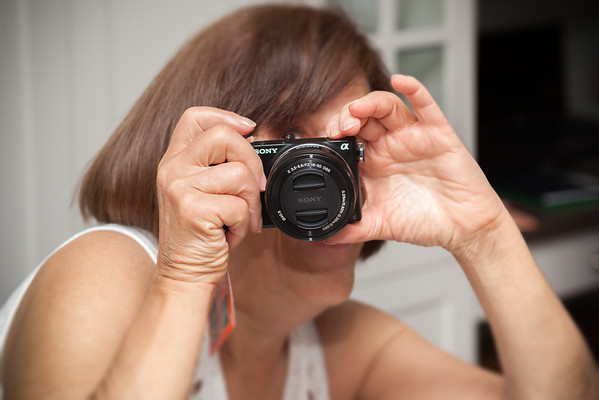 Mom likes her new gift, but needs to learn how to use it (*cough* lens cap *cough* *cough*)