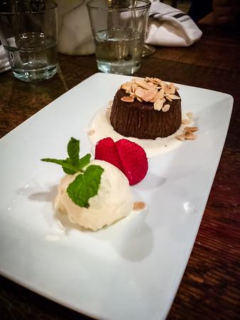 For dessert, we share a Torta di Cioccolato - dark chocolate flourless cake, roasted almonds, vanilla gelato