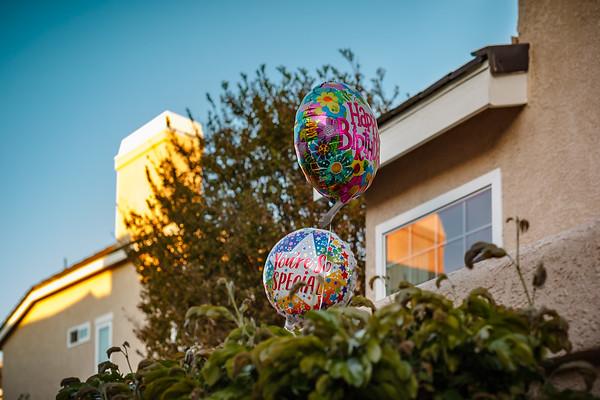 Birthday balloons greet Valerie outside of Jane's place
