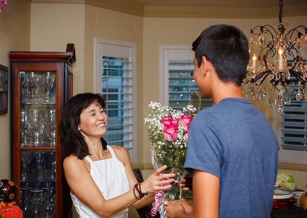 Jayden gives Valerie flowers for her birthday