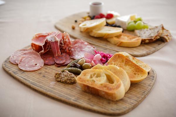 Charcuterie - Alsatian garlic sausage, prosciutto, chorizo, sopressata served with pickled vegetables, whole grain mustard, baguette