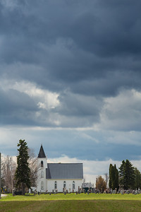 Wolford United Church under a threatening sky