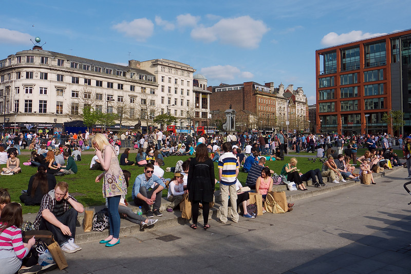 The first really warm weekend of the year and Piccadilly Gardens is predictably packed.