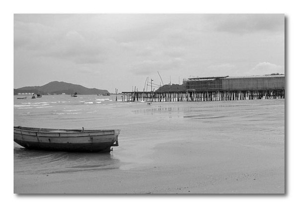 Fishing boat at low tide - Gulf of Siam.<br /> This was photographed on a cloudy, cool and rainy day.