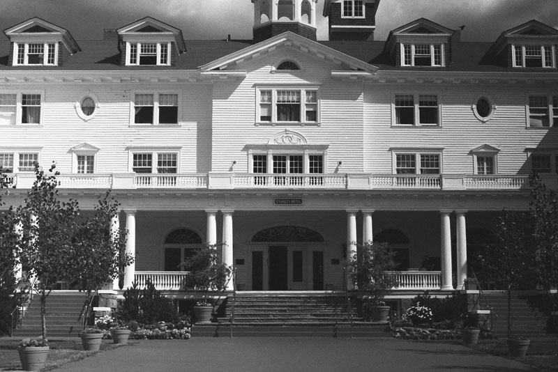 The Stanley Hotel in Estes Park, Colorado.<br /> We stayed in the Stanley Hotel and later heard that it was haunted...<br /> but we experienced nothing out of the ordinary -- at least for us.<br /> Scanned from a 35mm negative shot in 1995. (A wide-angle lens would have been useful here).
