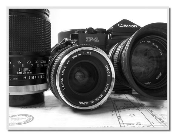 Canon F-1 and lenses sitting on our house plans.<br /> This image was shot with our Canon S30.<br /> I originally chose this subject as a black and white because<br /> everything in this composition is actually black or white (or chrome).