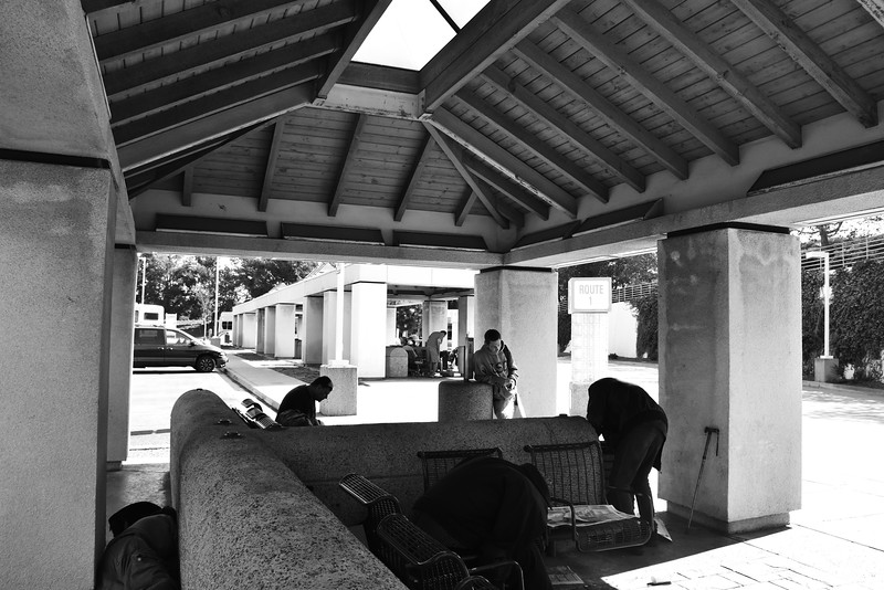 Disabled People Waiting for Bus at Newport Beach Transit Center in California black and white