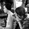 Getting a Tatoo at the Orange County Fair in Costa Mesa California 2 black and white
