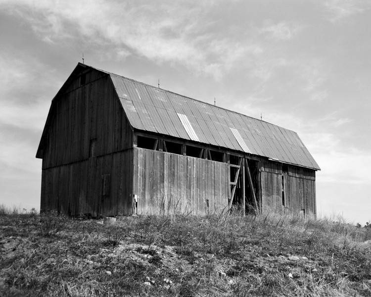 Another local barn that I've obtained permission to enter the property in order to get closer to the barn to photograph it.<br /> <br /> Anniversary Speed Graphic 4x5 camera loaded with Ilford FP4+, tray developed in D76 for 9.5 minutes at 19C.