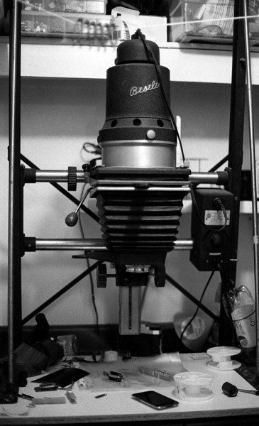 Testing what I thought was fogged film. Boring shot of my Besseler 45M enlarger. I took a bunch of quick boring shots to use up the roll so I could hurry up and develop it to see if the film was in fact fogged or not. As it turned out, just the edges had been fogged.<br /> <br /> The lab I bought the enlarger from indicated that it was 50 years old when they got it. I believe that this model started production in 1953.<br /> <br /> ORWO N74 plus cine film developed in HC-110 for 6 minutes at 20C. Minolta Maxxum 7 used to take the photos.
