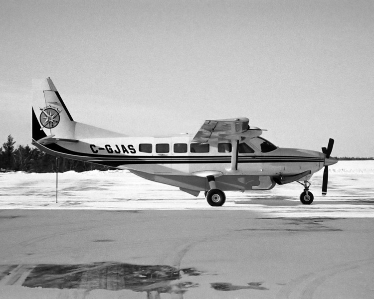 This Cessna 208 Caravan was sitting on the Dryden ramp waiting for passengers.<br /> <br /> Voighander Vito B with Adox CHS 100 ART developed in Kodak D76 for 8 minutes and 45 seconds at 18C.