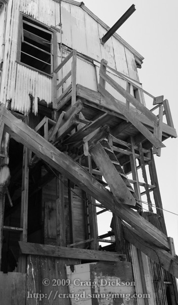A decaying ruin of a building (probably a warehouse or factory) in the Eden Landing industrial area of Hayward, California, near to where the San Mateo Bridge comes ashore.