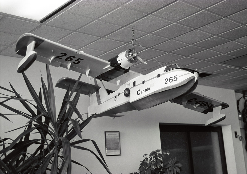 This is a model of a CL-215 that is hanging in the Dryden airport. Tanker 265 used to be stationed at the Dryden  MNR but was sold to Minnesota when the MNR upgraded to CL-415's.<br /> <br /> This was a test roll of Kodak T-Max 100 that was two years past its due date. I rolled this film my self using a Watson bulk film loader, and developed the negatives myself using Kodak D76 for 7.5 minutes at 20C. I took the photo with a Leica R4 using a Leica 35-70mm lens.<br /> <br /> I lost half of the roll as the film did not go onto the developing reel properly. Out of a roll of 12 exposures, I got 4. The rest were ruined.