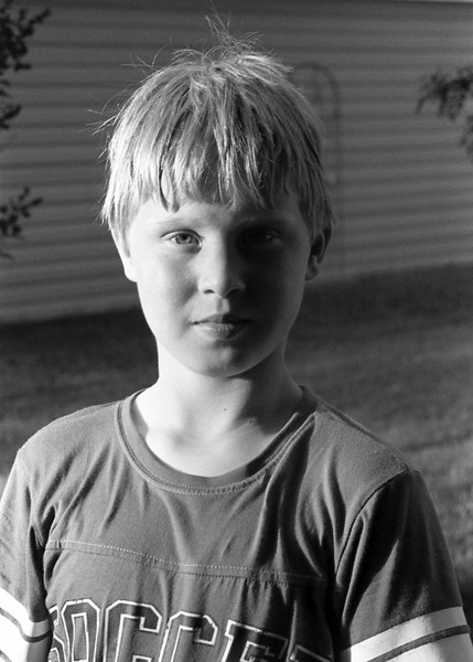 John in the front yard in the evening (18:40 or so). Leica R4, Kodak PX 125 in Rodinal. Developing time was not recorded but I believe it was for 6 mins at 20C.