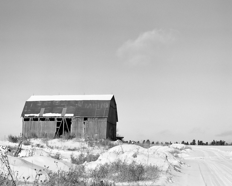 This old barn in just off the highway close to town which is why I have taken so many photos of it. I use this as a subject not only due to its location, but to test different films and cameras.<br /> <br /> Today I wanted to shoot a roll of 120mm film so I headed out with my Fuji Professional GW670 II medium format camera and loaded it with Ilford Pan F+ and grabbed my hand held Sekonic L-308S light meter as this camera has no built in light meter. <br /> <br /> I developed the negatives with Kodak D76 1:1 for 11.75 minutes at 19C. This is the first roll of 120mm film that I developed myself at home.