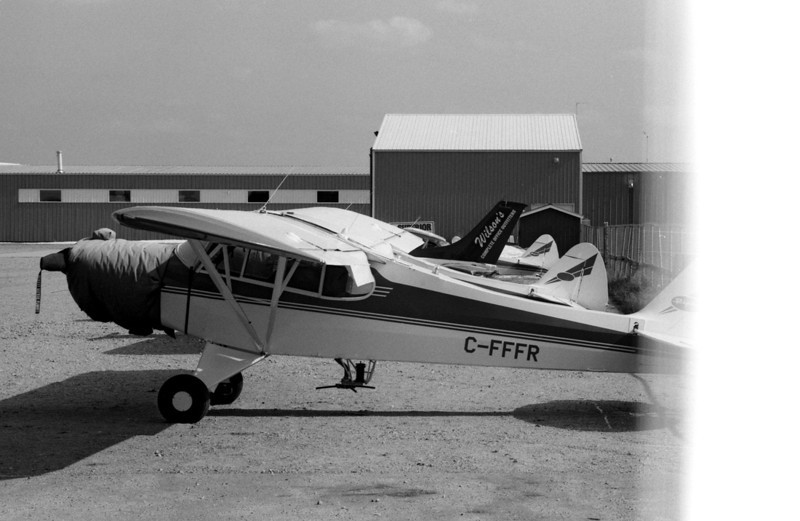 Don't you just hate that! Last frame on the roll and you run out of film ( Hand rolled film)!<br /> <br /> Piper Super Cub (C-FFFR) at the Dryden airport. <br /> <br /> Leica R4, ORWO UN54 rated at 80 developed in HC-110 dilution 'J' (1:150) for 20 mins at 19C.