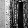 4/2011:  Detail of tiled arch and curtain at Paramount Theater, Anderson, Indiana.  Scott Kelby's CS3 Gradient Layer  adjustment layer method for black & white was used.  Then a consolidated  layer was created and Adjust Sharpening applied, but no additional filters.