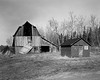 Yet another view of the Findlay barn but this time with another building. I have no idea when the smaller building was constructed but the barn was built in 1928 by Bill Findlay.<br /> <br /> The barn finally collapsed during the summer of 2010.<br /> <br /> Graflex Speed Graphic 4x5 camera (1940-1946) with Ilford FP4+ film tray developed in Kodak D76 for 8.5 minutes at 20C.