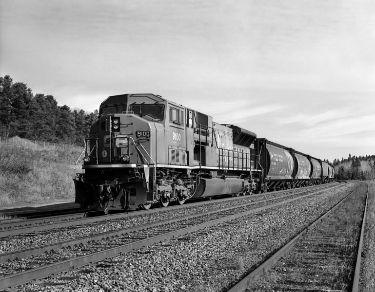 CP 9100 West sitting on the siding at Hawk Lake Ontario.<br /> <br /> 1/125th of a second at F11. Pentax 645N medium format camera, Pentax FA 75mm 1.28 lens. The camera was loaded with Rollie 80s b&w film stand developed in Rodinal 1:100 for 45 minutes at 21C.
