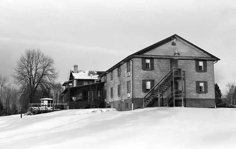 The Riverview Lodge in Dryden Ontario as it sits today in 2008. The original wood timber building circa 1910.<br /> <br /> Ilford HP5+ developed in Kodak D76 for 7.5 minutes at 20C. Minolta Maxxum 7 with a Sigma 28-300mm lens.