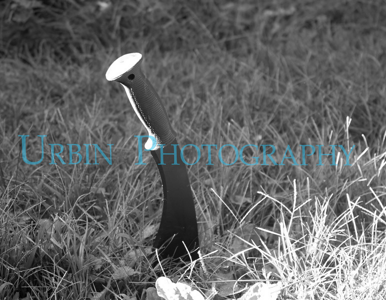 A Kukri knife in the grass