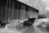 Stream under covered bridge