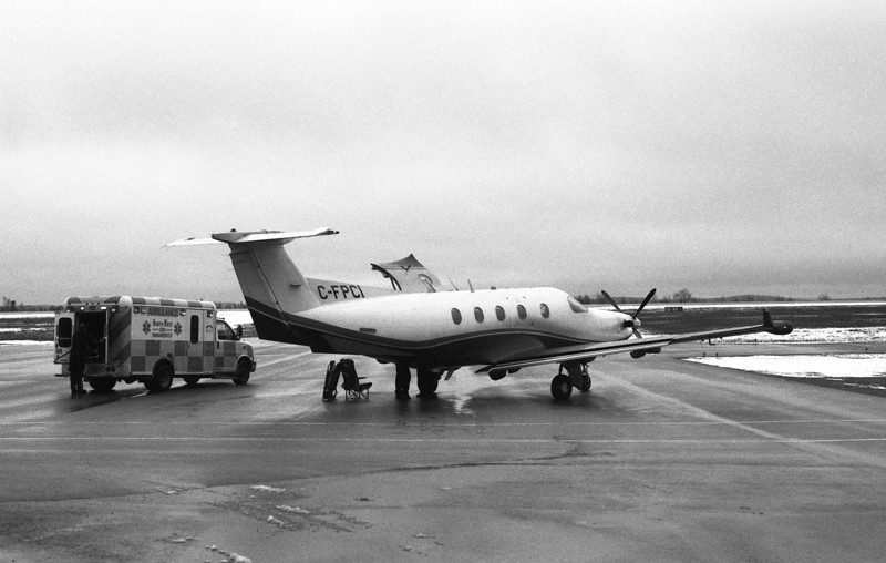 Medi-vac getting read to transfer a patient on a dreary wet, overcast day.<br /> <br /> Pentax ME loaded with ORWO UN54 rated at 100 iso. Film developed in HC-110 dilution J (1:150) for 20 minutes at 18C. Agitated first 60 seconds then again for 5 seconds after each 30 seconds.