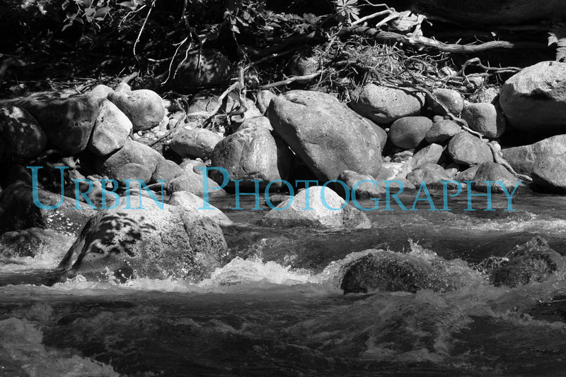 A black & white image of the Merced River at Happy Isles.
