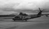 Ornge sitting on the ramp with a Sikorsky 76. And yes the machine was orange, and no the company name is not incorrectly spelled.<br /> <br /> Pentax ME loaded with ORWO UN54 rated at 100 iso. Film developed in HC-110 dilution J (1:150) for 20 minutes at 18C. Agitated the first 60 seconds then again for 5 seconds after each 30 seconds.