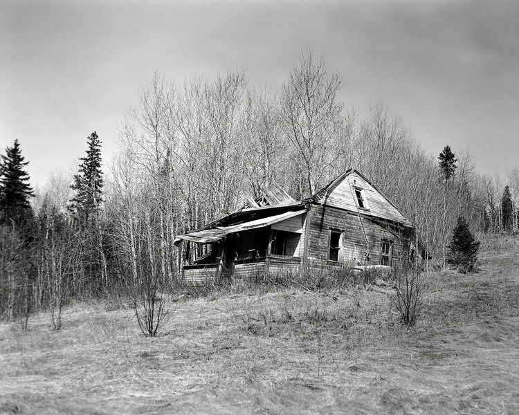 This abandoned homestead doesn't have much time left I don't think. In the past 6 months the roof has caved in.<br /> <br /> Graflex Speed Graphic 4x5 camera (1940-1946) loaded with Ilford FP4+ tray developed in Kodak D76 for 8.5 minutes at 20C.