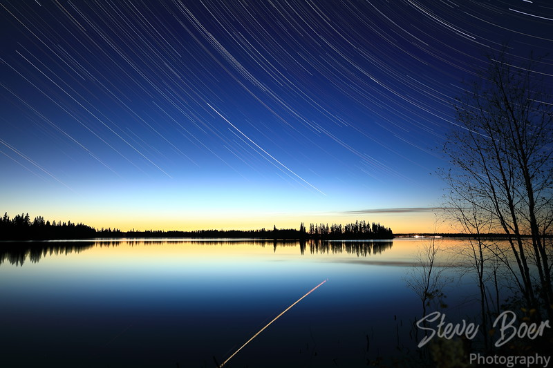 Star trail at Elk Island with reflection