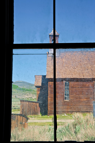 BE125.  A view of the church through a window.