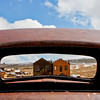 BE104  Bodie State Park. Exterior shots.  Through the back window of rusting car.
