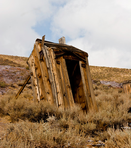 BE132.  Collapsing outhouse.