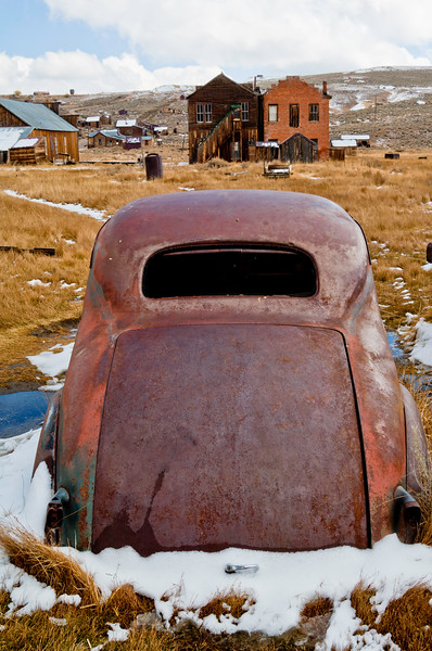 BE122.  Melting snow on rusting car.