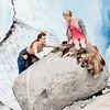 Kristian hoists Emma up the rock