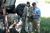 Carlo Iori and Guide, B.K. enjoy coffee served on the tailgate, Near Xakanaxa, Moremi Game Reserve, Okavango Delta, Botswana