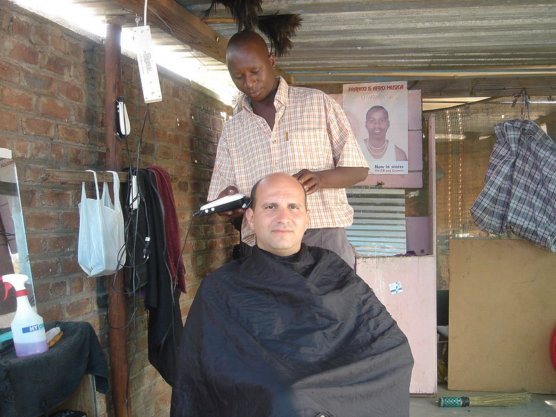 Andrew Goldman having Hair Cut at This is Your Haircut, Gaborone Bus Station, Gaborone, Botswana